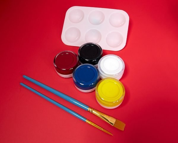 small kit of painting supplies like brushes, paints and a palette